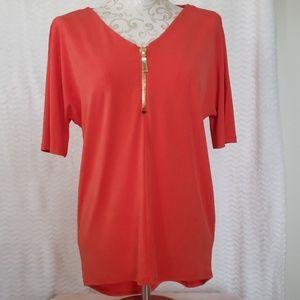 Grace orange top with decorative gold zipper